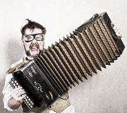 Steampunk accordion player Stock Photo