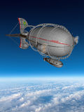 Steampunk Airship Clouds Blue Sky. Steampunk airship taking flight above the clouds with a deep blue sky. The zeppelin is a retro style fantasy flying machine Stock Photo