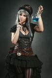 Steampunk alchemist woman with potion Royalty Free Stock Image