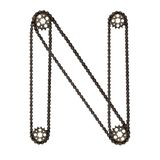 Steampunk font. Letter N from chain gear elements, tires, reflectors stock photo