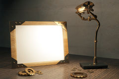 Steampunk background with blank picture frame and lamp  Royalty Free Stock Image
