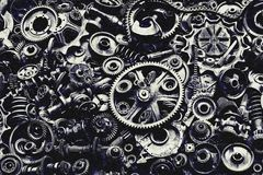 Steampunk background, machine and mechanical parts, large gears and chains from machines and tractors. Steampunk background, machine parts, large gears and stock photography