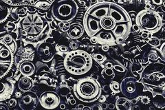 Steampunk background, machine and mechanical parts, large gears and chains from machines and tractors. Steampunk background, machine parts, large gears and stock images