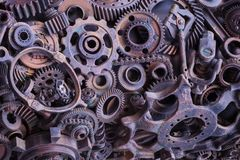 Steampunk background, machine parts, large gears and chains from machines and tractors. stock photos