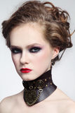 Steampunk beauty. Portrait of young beautiful girl with stylish hairdo and fancy steampunk collar Royalty Free Stock Photos