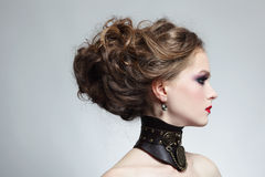 Steampunk beauty. Portrait of young beautiful girl with stylish hairdo and fancy steampunk collar Stock Photo