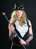 Steampunk Female. Steampunk female with a cane, top hat and goggles Stock Photography