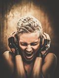 Steampunk flicka med hörlurar fotografering för bildbyråer
