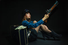 Steampunk girl armed and dangerous. Royalty Free Stock Photo
