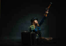 Steampunk girl with cash. Royalty Free Stock Image
