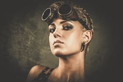 Steampunk girl with googles. Attractive steampunk girl wearing googles Royalty Free Stock Image