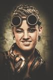 Steampunk girl with googles. Attractive steampunk girl wearing googles Royalty Free Stock Photos