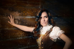 Steampunk Girl in Lolita Dress. Portrait of a young woman wearing a steampunk outfit stock photography