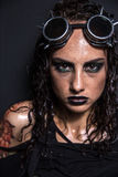 Steampunk Girl. Portrait of Brutal Steampunk Girl over Black Background Royalty Free Stock Photo