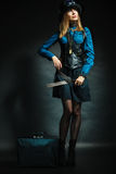 Steampunk girl with retro bag. Royalty Free Stock Images