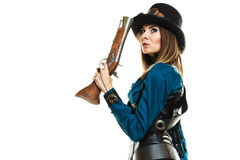 Steampunk girl with rifle. Young steampunk islolated girl on white holding fancy rifle. Fantasy old fashion wearing hat and goggle with copy space stock photo
