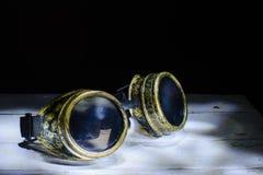 Steampunk glasses metal collage. Light brush stock photo
