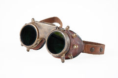 Steampunk goggles. Old vintage steampunk goggles isolated on the white background stock photos