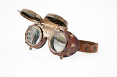 Steampunk goggles. Old vintage steampunk goggles isolated on the white background royalty free stock images