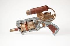 Steampunk gun. Steampunk weapon on the white background royalty free stock photos