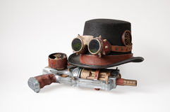 Steampunk hat, goggles and gun. Old steampunk hat, goggles and gun on the white background Stock Image