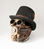 Steampunk hat, goggles and mask. Vintage steampunk hat, goggles and mask on the white background Stock Image