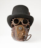 Steampunk hatt, skyddsglasögon och maskering fotografering för bildbyråer