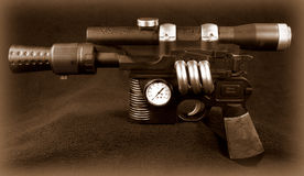 Steampunk Machine Pistol. Prop automatic pistol altered to look as if it is powered by steam, in old sepia tone Stock Photo