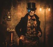 Steampunk man with gun on vintage steampunk background Stock Image