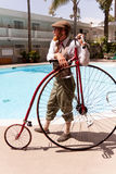Steampunk man with Penny Farthing Stock Photo