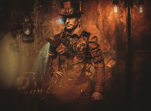 Steampunk man on vintage steampunk background.  Stock Photography