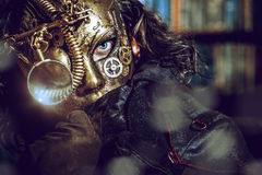Steampunk. Man wearing mask with various mechanical devices. Fantasy royalty free stock image