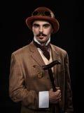 Steampunk-Mann in einem Hut und mit einem Stock Stockbild