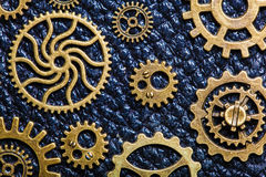 Steampunk mechanical cogs gears wheels on leather background Stock Photo