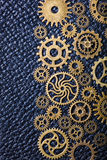 Steampunk mechanical cogs gears wheels on leather background Stock Photos