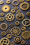 Steampunk mechanical cogs gears wheels on leather background Royalty Free Stock Images
