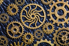 Steampunk mechanical cogs gears wheels on leather background.  Royalty Free Stock Image