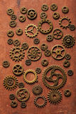 Steampunk mechanical cogs gears wheels on wooden background Stock Photos