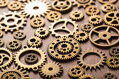 Steampunk mechanical cogs gears wheels on wooden background Royalty Free Stock Photos