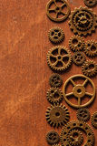 Steampunk mechanical cogs gears wheels on wooden background Royalty Free Stock Photo