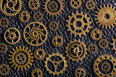Steampunk mechanical cogs gears wheels on wooden background Royalty Free Stock Images