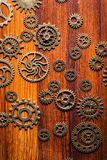 Steampunk mechanical cogs gears wheels on wooden background Stock Photography