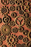 Steampunk mechanical cogs gears wheels on wooden background Stock Image