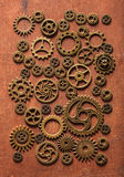Steampunk mechanical cogs gears wheels on wooden background Stock Images