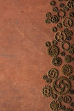 Steampunk mechanical cogs gears wheels on wooden background Royalty Free Stock Photography