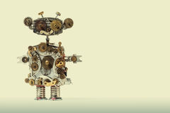 Steampunk mechanical robot. Aged gears, cog wheel hand clock parts mechanism. Shabby grunge scratch metal texture. Fun Stock Image