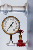 Steampunk metal pressure gauge on boiler tank Royalty Free Stock Photography