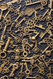 Steampunk old vintage metal keys background on leather Stock Photo