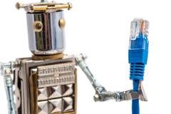 Steampunk robot holding lan cable. Stock Photos