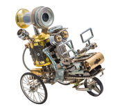 Steampunk robot on vehicle. Chrome and bronze parts. on white stock photos